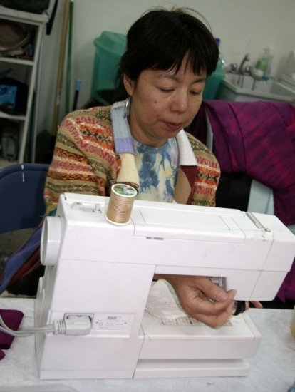 7. lily sewing 2